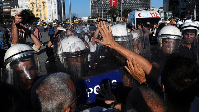 Turkish police beat protesters
