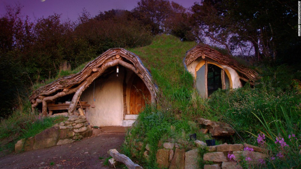 "Simon Dale built his own 'Hobbit House' for less than $5,000. Dale says the whole building was constructed with just a hammer, a one-inch chisel and a chainsaw, and was made largely of scavenged materials. Dale says: ""Anything you could possibly want is in a rubbish pile somewhere -- windows, burner, plumbing, wiring."""