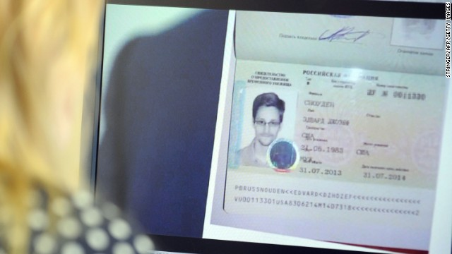 "A woman watches a footage on her computer, showing  the lawyer of fugitive US intelligence leaker Edward Snowden showing his client's one year's asylum permit at Sheremetyevo airport in Moscow on August 1, 2013. Edward Snowden, the US intelligence leaker who left a Moscow airport Thursday after winning asylum in Russia, will be helped in his new country of residence by ""American friends,"" his lawyer said.  ""I can open up the curtain a little. Of course he has acquired friends in Russia, American friends, who can ensure his security for some time,"" Russian lawyer Anatoly Kucherena told Rossiya 24 channel.     AFP PHOTO / STRINGERSTRINGER/AFP/Getty Images"