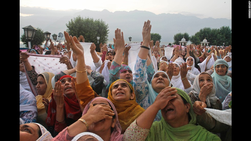 Muslim women pray on the 21st day of Ramadan at the Hazratbal Shrine in Srinagar, India, on Wednesday, July 31.