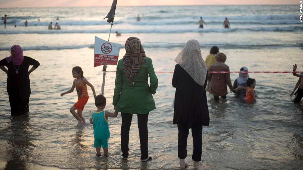 Muslims enjoy the Mediterranean sea in Jaffa, a mixed Jewish and Arab part of Tel Aviv, Israel, as they break the Ramadan fast at sunset on July 31.