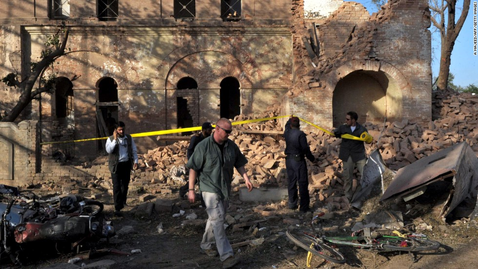 "Officials examine the aftermath of a terrorist attack outside the <a href=""http://www.cnn.com/2010/WORLD/asiapcf/04/05/pakistan.blast/index.html"">U.S. Consulate in Peshawar, Pakistan,</a> on April 5, 2010. The coordinated attack involved a vehicle suicide bomb and attackers who tried to enter the consulate by using grenades and weapons fire. Two consulate security guards and at least six others were killed."