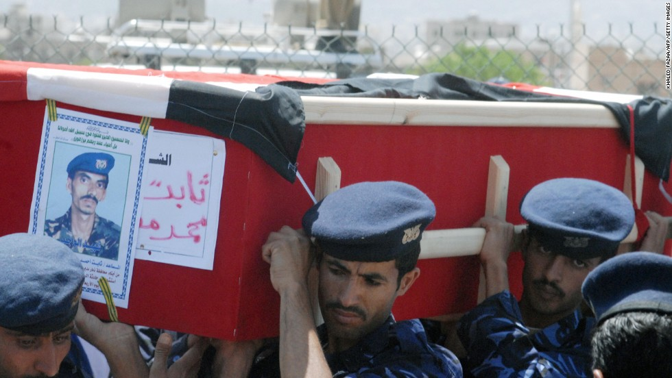 "Yemeni soldiers carry the coffin of a comrade during a funeral on September 25, 2008, in Sanaa. Heavily armed fighters attacked the <a href=""http://www.cnn.com/2008/WORLD/meast/09/17/yemen.blast/index.html"">U.S. Embassy in Yemen</a> on September 17. A car bomb was detonated, killing 10 Yemeni police and civilians and six attackers."