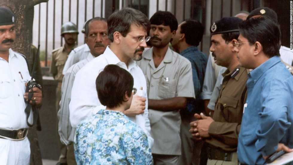 "Christopher Sandrolini, the U.S. consul general in Calcutta, speaks with Indian officials outside the <a href=""http://news.bbc.co.uk/2/hi/south_asia/1774483.stm"" target=""_blank"">U.S. government information center in Calcutta</a>, near the U.S. Consulate, where heavily armed gunmen killed five Indian police officers on January 22, 2002."
