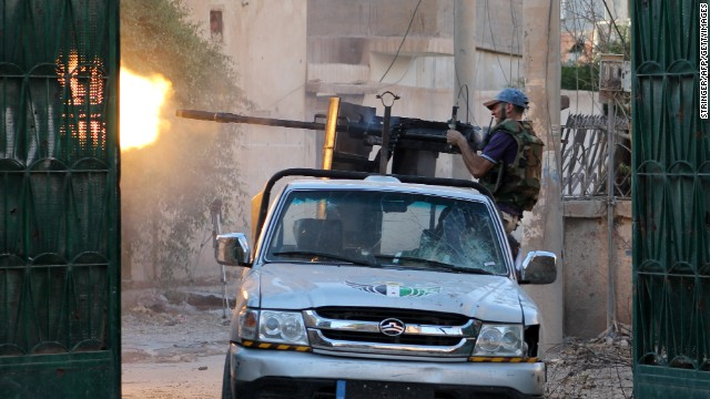 A rebel fighter fires from a truck during clashes with regime forces in Deir Ezzor, Syria, on Thursday.