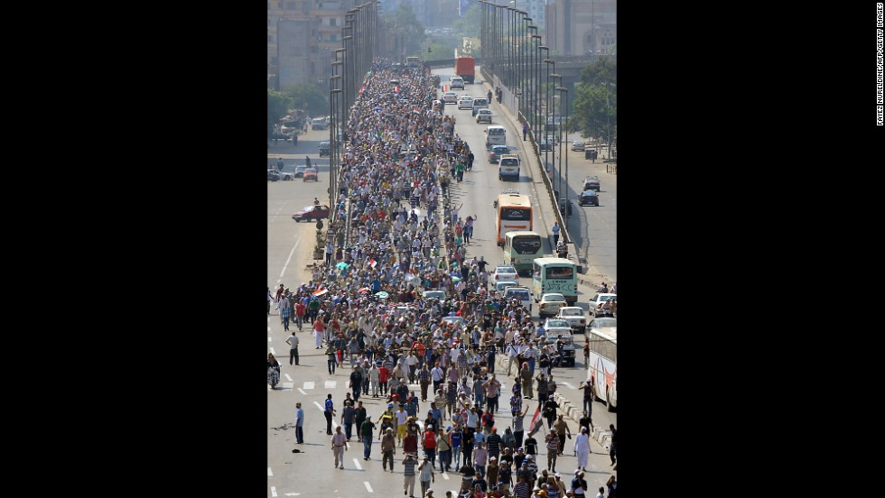 Morsy supporters march in a demonstration against the Egyptian government in Cairo on August 2.