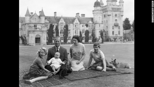 In this September 1960 photo, the Queen and Prince Philip pose on the lawn at Balmoral with their children, Prince Andrew, center, Princess Anne, left, and Prince Charles.