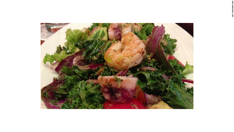 At Julian Serrano, grilled shrimp and octopus adorn a salad of avocados, tomatoes, Spanish olives, sliced red onions and kale dressed in a raspberry vinaigrette.