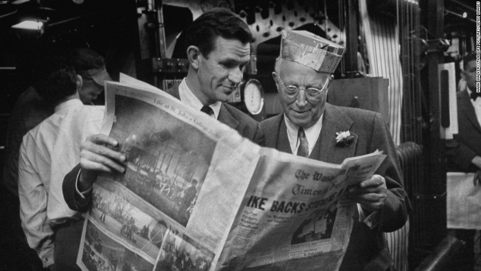 Owner Eugene Meyer, right, and publisher Philip Graham look over the first edition of the paper after the Washington Post and Times-Herald merger in 1954. Graham committed suicide in 1963, leaving his wife, Katharine, in charge of the company.