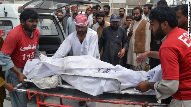 Pakistani volunteers shift the body of a victim, killed by rebels outside a hospital in Quetta on August 6, 2013.