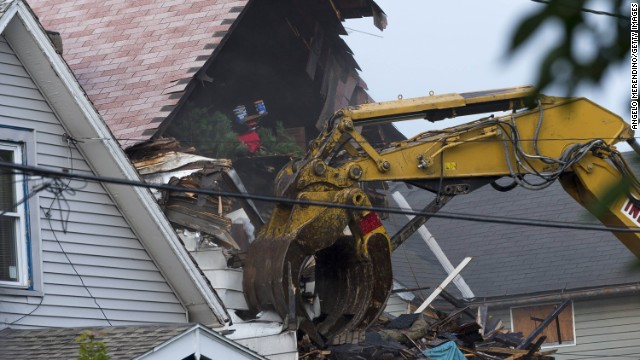 A crane demolishes the home of captor Ariel Castro in Cleveland on August 7.
