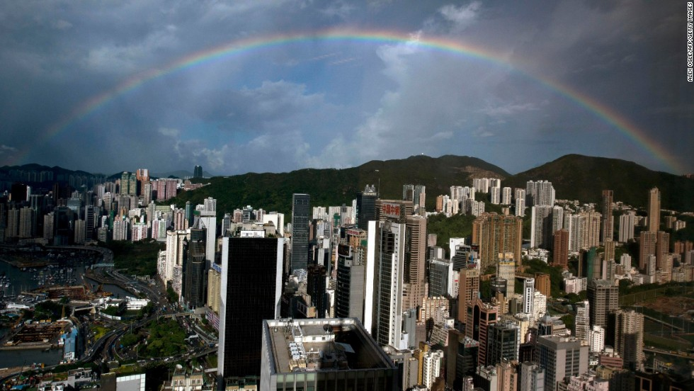 A rainbow appears in the skies above a Hong Kong office building on Wednesday, August 7. Click through to see other images of weather around the world.