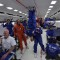 astronauts in an orbiting space shuttle experience a sensation of weightlessness because - photo #26