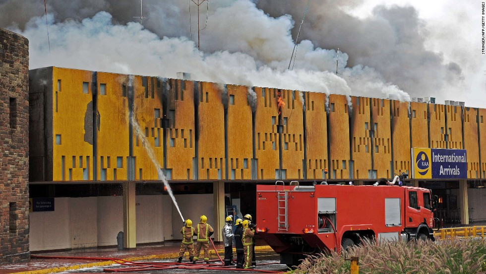 Firefighters try to control a blaze at the Jomo Kenyatta International Airport in Nairobi, Kenya, on Wednesday, August 7. Fire engulfed the airport's entire international terminal, but no casualties were reported. Domestic flights have resumed, and some international ones are set to begin again Thursday, August 8, a Kenyan official said.