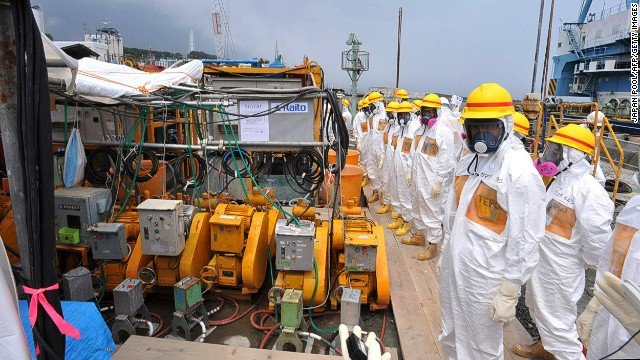 This photo taken on August 6, 2013 shows local government officials and nuclear experts inspecting a facility to prevent seeping of contamination water into the sea at Tokyo Electric Power's (TEPCO) Fukushima Dai-ichi nuclear plant in Okuma, Fukushima prefecture.