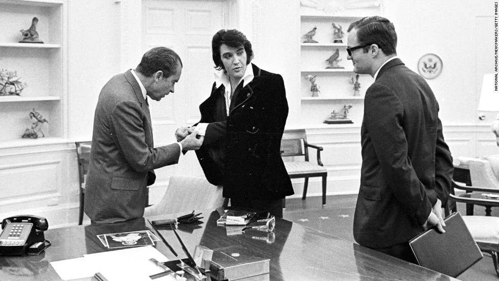 Elvis shows President Richard Nixon his cuff links at the White House on December 21, 1970.