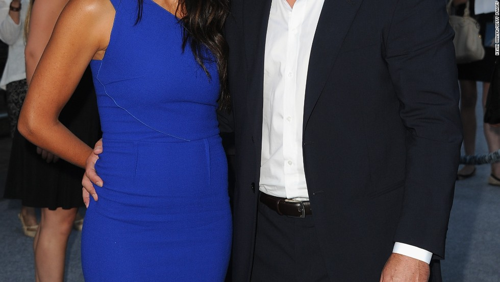"Matt Damon and his wife Luciana Barroso attend the premiere of ""Elysium"" on August 7."