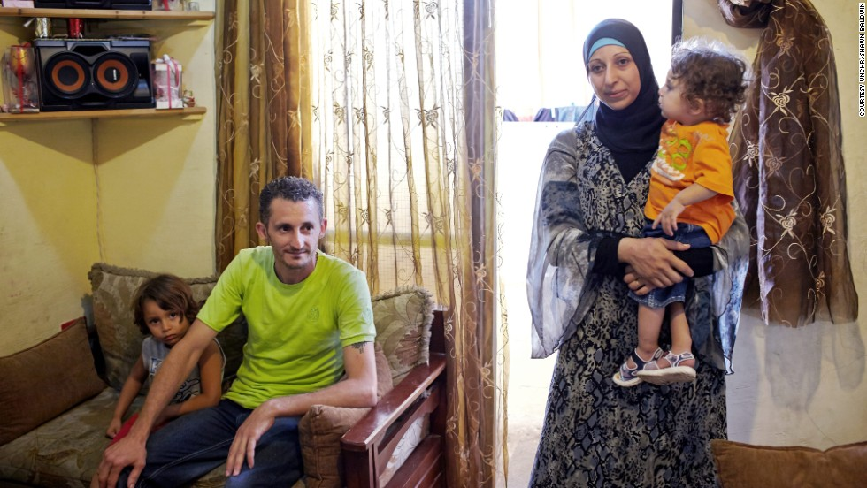 "Syrian refugee Hussein, 33, and his wife, Nuhad, 27, and their two children now live in a small apartment in Lebanon. ""I miss the atmosphere in Syria,"" said Hussein.  ""I miss the culture. I miss the Msahrji (the drummer who walks around the neighborhood and wakes people for Suhoor). I miss watching the Ramadan series on TV together."""