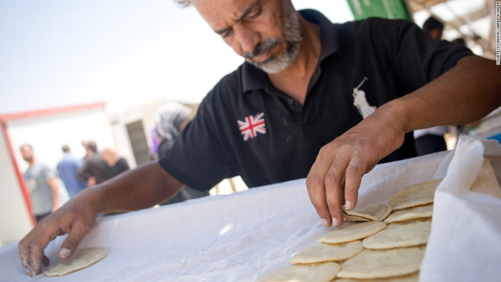 Yahya arranges his freshly made qatayef, sweet pancakes traditionally served during the Islamic fasting month of Ramadan. He was a baker in his native Syria and now puts his skills to use in Za'atari, Jordan.