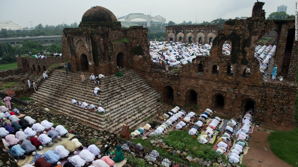 Indian Muslims offer Eid al-Fitr prayers on the ruins of the Feroz Shah Kotla fort and mosque in New Delhi on August 9. Muslims fasted from dawn until dusk during the holy month of Ramadan, the most sacred month in the Muslim year.