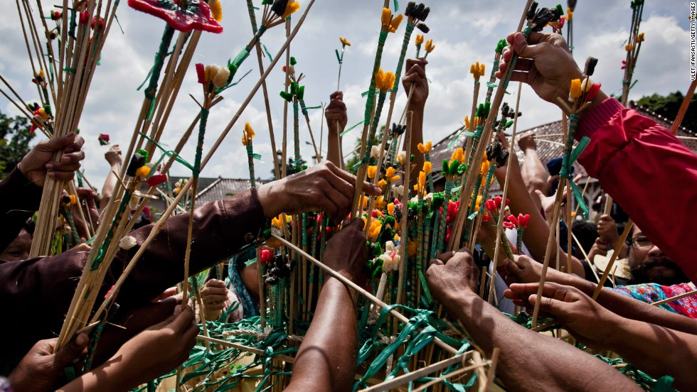 "Javanese people jostle the ""gunungan wadon"" during Grebeg Syawal ceremony on August 8, in Yogyakarta. Grebeg Syawal is a tradition that follows the holy month of Ramadan to welcome Eid Al-Fitr. The tradition involves an offering of vegetables, peppers, eggs, and other items, called gunungan wadon brought to the Grand Mosque."