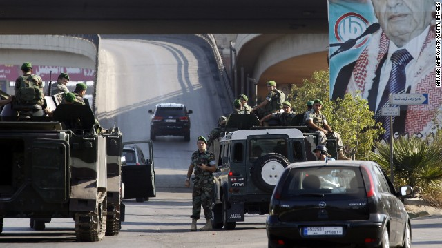 Troops patrol the airport highway outside Beirut on August 9 following the kidnapping of two pilots working for Turkish Airlines.