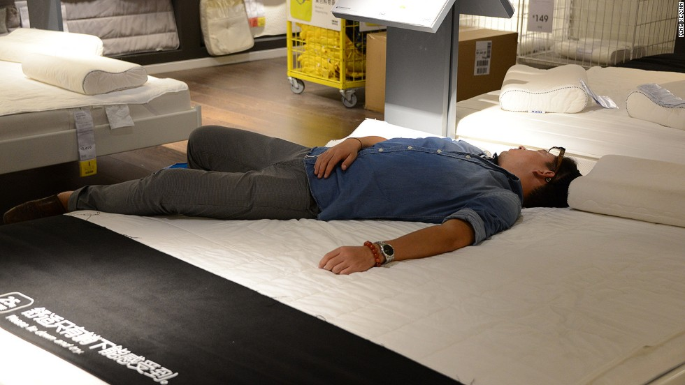 "Ikea's latest mattress commercial? ""You can only feel the comfort when you lie down,"" says the sign in Chinese. This ""customer"" needed no further invitation."