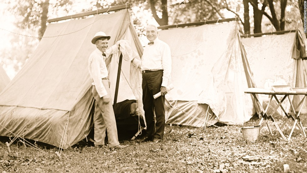 President Warren Harding, right, goes camping with Firestone Tire founder Harvey Firestone in 1921.