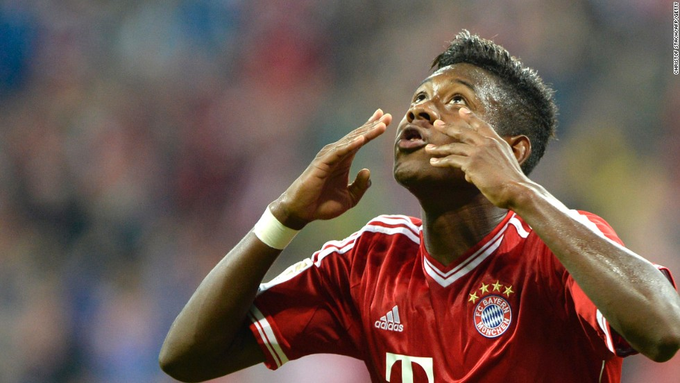 David Alaba celebrates scoring his side's clinching third goal from the penalty spot in the 3-1 win over Borussia Moenchengladbach.