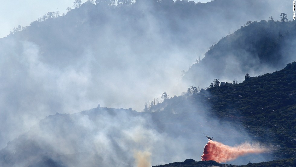 An air tanker drops fire retardant on a hot spot as firefighters continue to battle a wildfire on Friday, August 9, near Banning, California.