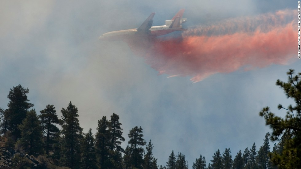 An air tanker, known as Tanker 911, drops retardant over the Sharp Fire near Wrightwood on August 9.