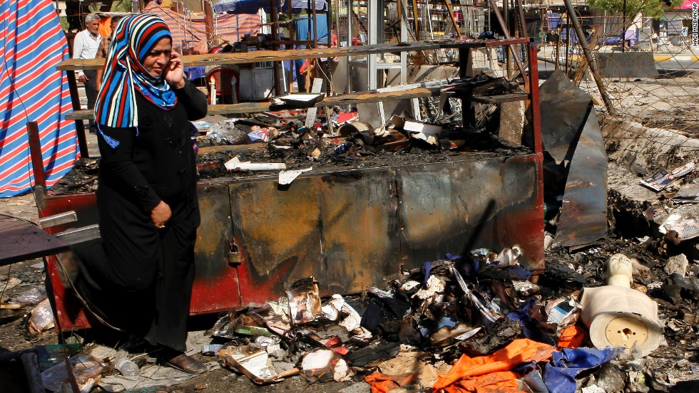 "A woman inspects the aftermath of a car bomb attack on a store in Baghdad on Sunday, August 11. <a href=""http://www.cnn.com/2013/08/10/world/meast/iraq-violence/index.html"">Bloodshed erupted Saturday throughout Iraq</a> as dozens were killed and more than 190 wounded in a wave of bombings amid Eid festivities, which mark the end of the holy month of Ramadan."