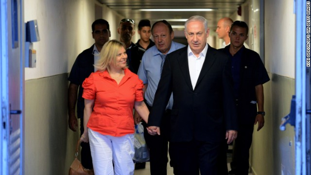 Israeli Prime Minister Benjamin Netanyahu and his wife, Sara walk out of the hospital after hernia surgery in Jerusalem.