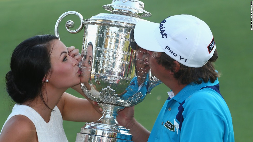 Dufner hugged wife Amanda after clinching victory and the two soon got up close and personal with the winners' trophy.