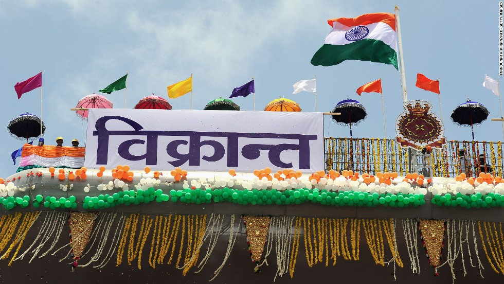 Flags wave atop the INS Vikrant on August 12.
