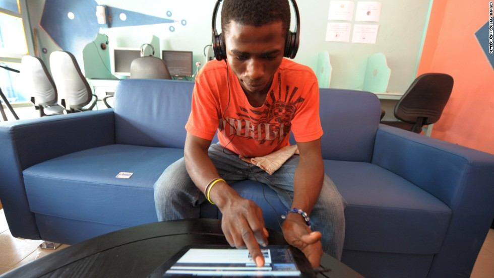 "A client uses a tablet computer in the world's first cybercafe equipped with tablet computers, in the Medina, a popular district of Dakar. ""Dakar is a good jumping off point into Francophone sub-Saharan Africa and due to the large number of international companies headquartered there for central and west Africa, many have global connections that can take their startups to the next level,"" Squibb said."