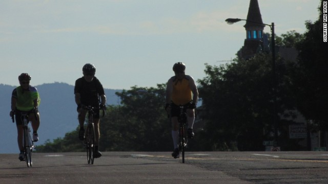 Rae Timme, left, and her friends start the long bike to work in the early morning hours.