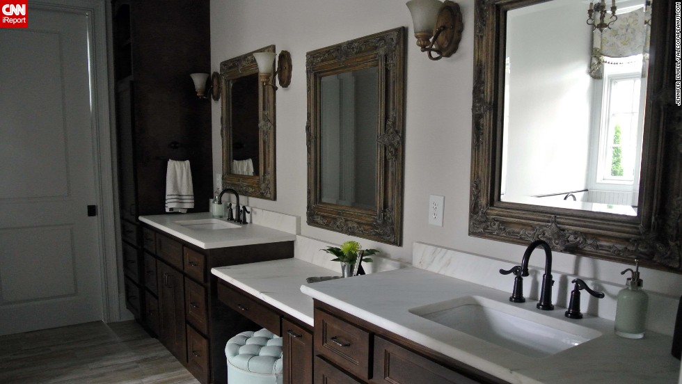 "<a href=""http://ireport.cnn.com/docs/DOC-1017236"">Jennifer Elwell's</a> master bathroom mixes <a href=""http://www.talesofapeanut.com"" target=""_blank"">traditional and rustic</a> decor."