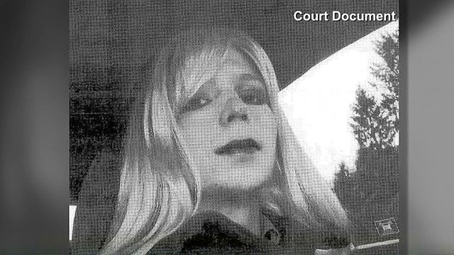 Photo shows Manning dressed as woman