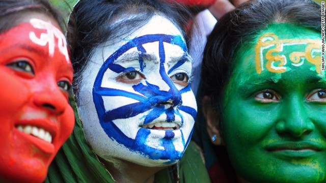 Indian students, their faces painted with the colours of their national flag, pose on the eve of Independence day in Allahabad on August 14, 2013. India celebrates its 66th independence anniversary from British rule on August 15.