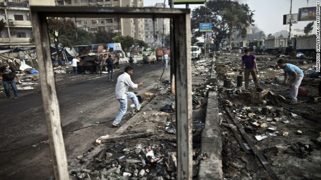 People search through the debris at Rabaa al-Adawiya square in Cairo on Thursday, August 15, following a crackdown on the protest camps of supporters of Egypt's ousted president Mohamed Morsy yesterday.