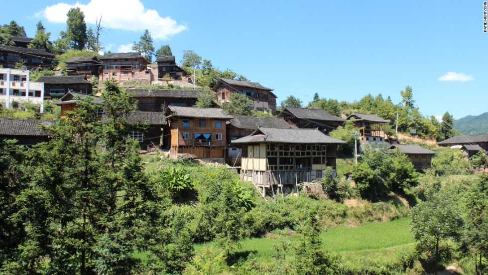 Long's village, Kongbai, clings to a steep-sided valley in China's poorest province, Guizhou.