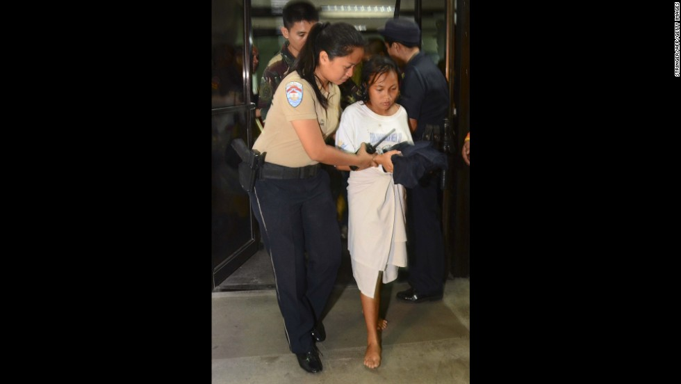 A young survivor is helped into the hospital on August 17.