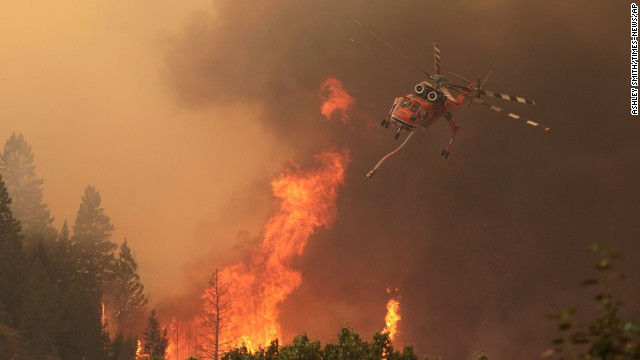 A helicopter battles the Beaver Creek fire on Friday, August 16 north of Hailey, Idaho.