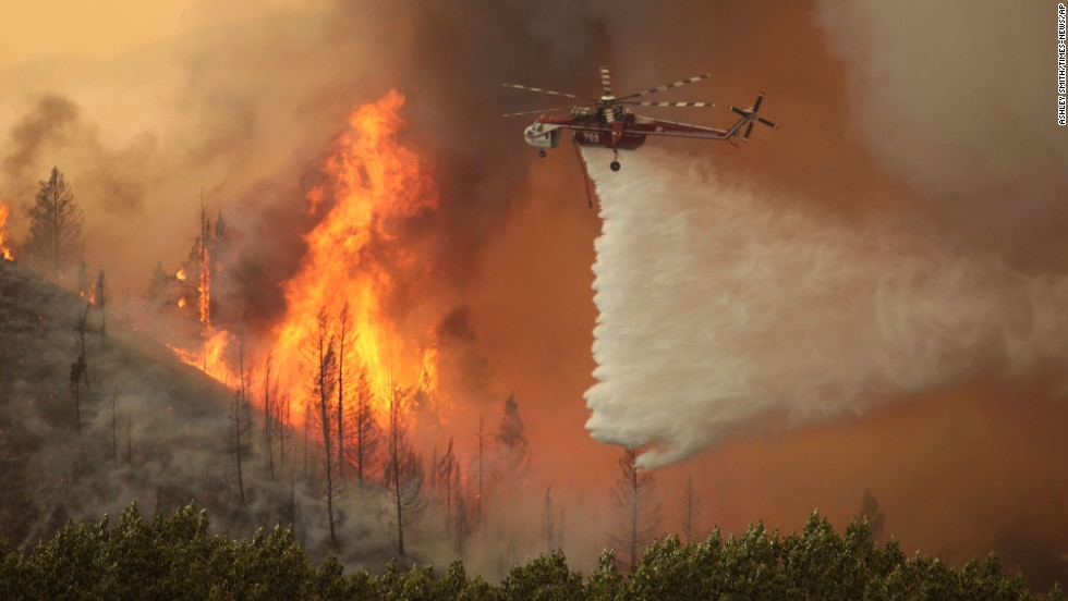 A helicopter battles the flames near Hailey on Friday, August 16. The Beaver Creek Fire was ignited by lightning on August 7.