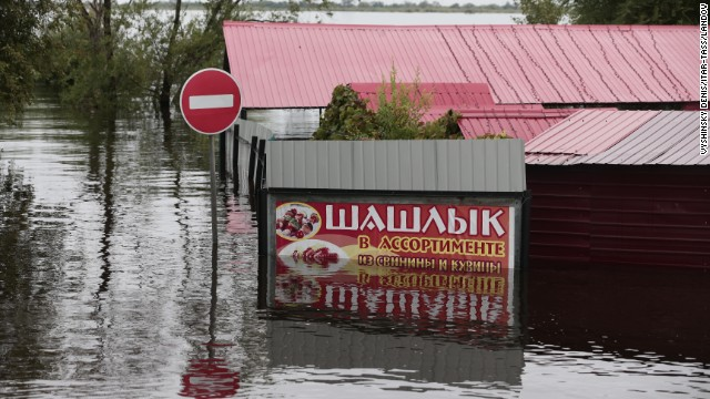 Flood waters hide the streets in Blagoveshchensk, Russia, on Friday, August 16. Aid was being flown into the city on Saturday.