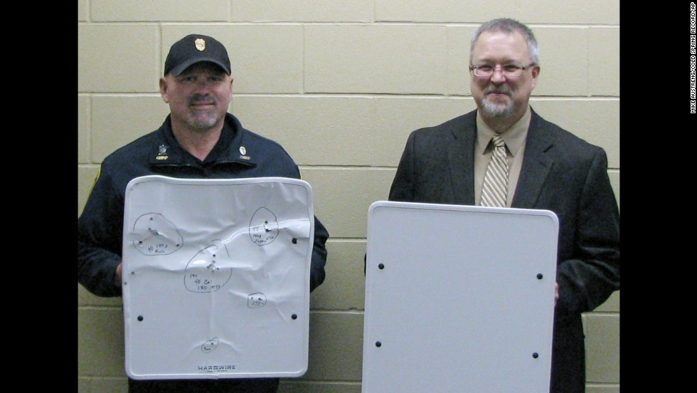 "Ahead of the fall semester, <a href=""http://www.cnn.com/2013/08/17/us/maryland-armored-whiteboards/index.html"">the University of Maryland-Eastern Shore announced </a>that it is purchasing 200 bulletproof whiteboards from Hardwire LLC, a company based in Pocomoke City, Maryland. The shootings at Sandy Hook were a factor, said Juliette Bell, the university president. ""Anything that we can do that could potentially save a life, we are going to explore,"" she said. Pictured, Police Chief Phil Jones, left, and Rocori School District Superintendent Scott Staska of Cold Spring, Minnesota, where schools acquired the kevlar whiteboards."