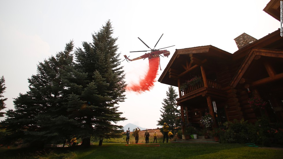 A helicopter drops fire retardant to protect homes outside Ketchum, Idaho, from the Beaver Creek Fire on Sunday, August 18.