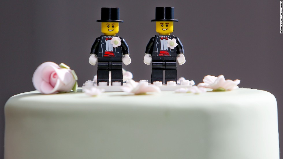 Two Lego men decorate the top of Paul McCarthy and Trent Kandler's wedding cake at their reception in Wellington on August 19.