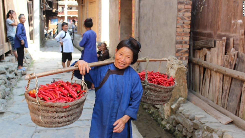 Many women in the village, which is home to the Dong ethnic group, still prefer to wear traditional dress.